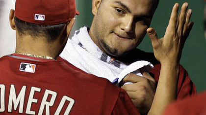 Diamondbacks pitcher Yusmeiro Petit, right, celebrates with teammate Alex Romero after pitching eight innings.