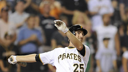 Pirates first baseman Adam LaRoche flies out with the bases loaded in the bottom of the ninth for the final out of the game last night.
