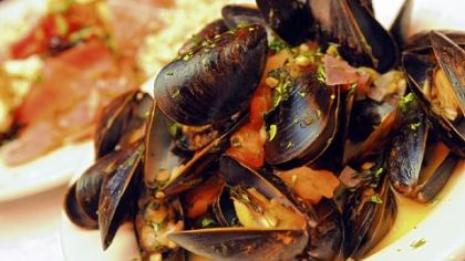 During Lent, Pizzutti's offers all-you-can-eat mussels, served above in a sauce made with tomatoes and white wine.