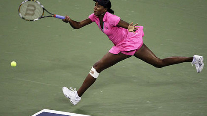 With her knee bandaged, Venus Williams stretches to hit a return during her match against Vera Dushevina at the U.S. Open in New York yesterday.