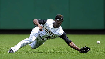 Pirates outfielder Andrew McCutchen pulls in a ball hit by Cubs outfielder Jake Fox in the fourth inning last night.