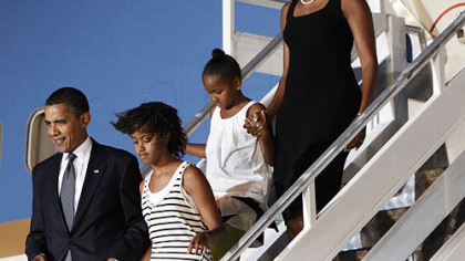 President Barack Obama and first lady Michelle Obama arrive in Accra, Ghana with their daughters Sasha and Malia on Friday.