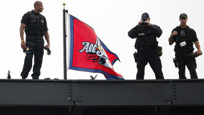 Police maintain position on the roof of Busch Stadium.