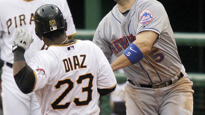 Pirates catcher Robinzon Diaz is tagged out by Mets third baseman David Wright during the eighth inning yesterday's game. Diaz was tagged out on a grounder by Pirates outfielder Andrew McCutchen, who was safe at first.