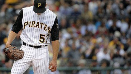 Pirates starter Zack Duke hangs his head after giving up his sixth run of the afternoon against the Braves yesterday at PNC Park.