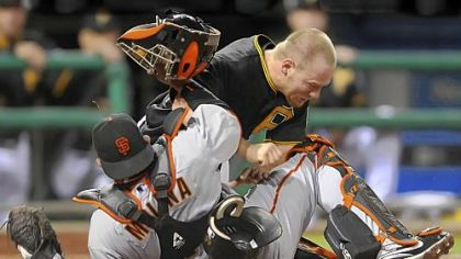 Pirates outfielder Brandon Moss collides with Giants catcher Bengie Molina in the seventh inning.