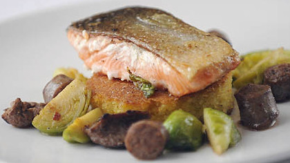 Jail Island Salmon with cornbread, merguez lamb sausage and brussel sprouts.