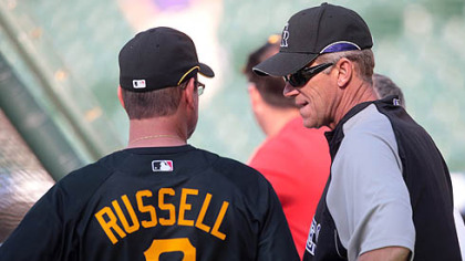 Pirates manager John Russell, left, chats with former Pirates manager and current manager of the Rockies, Jim Tracy, before a last night&#039;s game.  Tracy, who managed the Pirates for two seasons, was facing his former team for the first time since taking over as the manager of the Rockies.