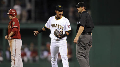 Pirates shortstop Ronny Cedeno argues with second base umpire Brian Knight after a close play on Diamondbacks infielder Mark Reynolds at second base in the sixth innning Tuesday night.