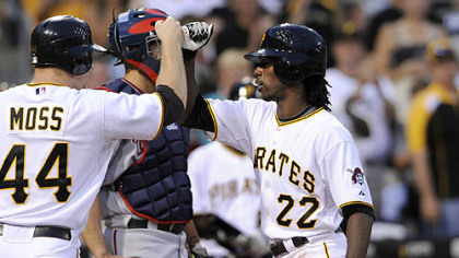 Andrew McCutchen is congratulated by teammate Brandon Moss after hitting a home run against the Nationals in the fourth inning last