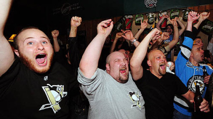 Fans celebrate at Shale&#039;s Cafe on Fifth Avenue as the Penguins win the Stanley Cup, beating the Red Wings 2-1 in Detroit.