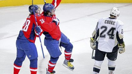 Capitals left wing Alex Ovechkin, center, celebrates his goal with Alexander Semin as Matt Cooke skates by in the first period yesterday in Washington.