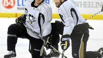 Sidney Crosby and Sergei Gonchar take a break during practice yesterday at Mellon Arena. The Penguins and Red Wings meet tonight in Game 6.