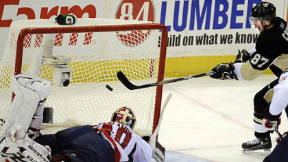 Sidney Crosby scores against Capitals goaltender Simeon Varlamov late in the third period to force overtime last night.