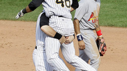 Garrett Jones is lifted off the ground by teammate Ryan Doumit after hitting a walk-off single off pitcher Trevor Miller in the ninth inning in Sunday's game against the Cardinals.