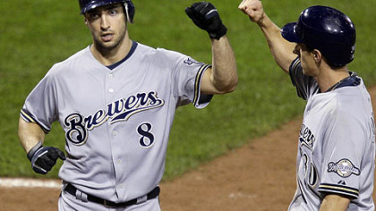 Brewers outfielder Ryan Braun (8) is greeted by teammate Craig Counsell after hitting a two-run home run in the ninth inning off Pirates pitcher Jesse Chavez.
