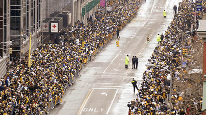 Fans line the Boulevard of the Allies awaiting the start of the Steelers Super Bowl parade, Downtown.