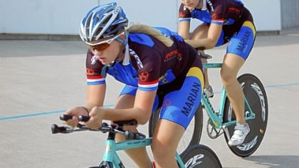 Sinead Miller and teammate Sierra Siebenlist riding in a summer competition at Major Taylor Velodrome.