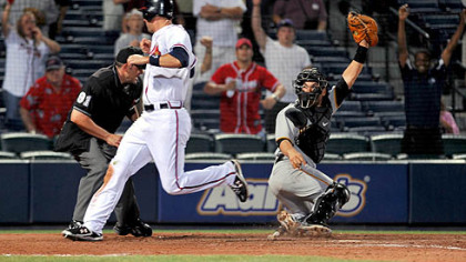 Braves' Jeff Francoeur scores past Pirates catcher Jason Jaramillo on a single off the bat of Braves' David Ross in the 15th inning early Tuesday morning in Atlanta.
