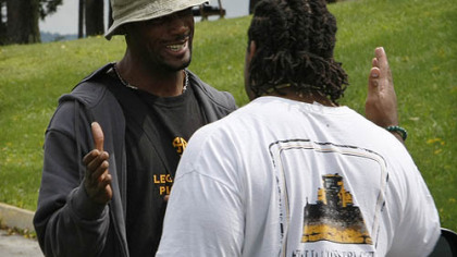 Steelers wide receiver Limas Sweed, left, greets offensive lineman Willie Colon as they arrive at training camp.