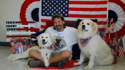 Luke Robinson of Austin, Texas  with his dogs, Murphy and Hudson.