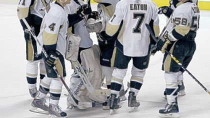 Penguins goalie Marc-Andre Fleury, third from left, is congratulated by teammates after making 31 saves to beat the Florida Panthers last night in Sunrise, Fla.