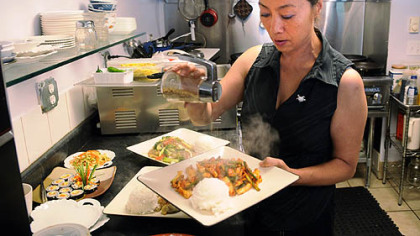 Yong Kwon prepares Oh Jing Un Bockeum (spicy squid) in the kitchen of her Cecil restaurant.