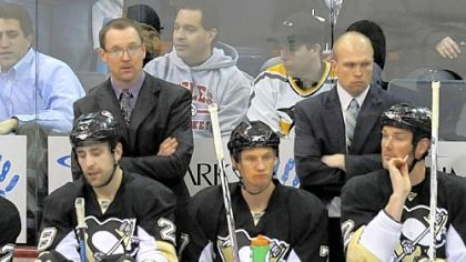 New Penguins interim coach Dan Bylsma stands next to assistant coach Mike Yeo in Thursday night's win over Montreal. The Penguins face two critical games this weekend.
