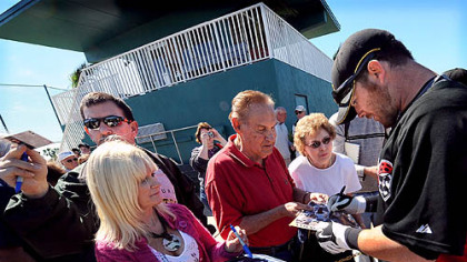 Pirates catcher Ryan Doumit signs autographs for fans at the end of a recent workout at Pirate City in Bradenton, Fla.