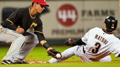 Pirates shortstop Ronny Cedeno tries to tag Houston Astros second baseman Kazuo Matsui on a steal during the third inning. Matsui later scored on a double by first baseman Lance Berkman.