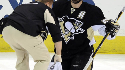 Sergei Gonchar is attended to after a knee injury that forced his exit in the first period of last night&#039;s playoff game against the Washington Capitals at Mellon Arena.