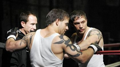 "Eric Hibler, left, owner of Eric Hibler's Pittsburgh Fight Club, talks with stunt double Jace Jeanes, center, and actor Tom Hardy before a take on the set of ""Warrior."""