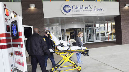 Children's Hospital carries out a mock move into its new quarters in Lawrenceville yesterday. Ambulance teams brought in mannequins on gurneys. The drill was in preparation for the actual move, which will take place May 2.