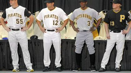 Freddy Sanchez, Nyjer Morgan and Nate McLouth model the three Pirates uniforms that will have sleeves this season. The pinstriped model will keep the jersey vest of previous seasons.