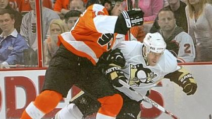 The Flyers' Mike Richards crunches Rob Scuderi against the boards in the first period of Game 4 of the NHL playoffs first-round series at Wachovia Center in Philadelphia.