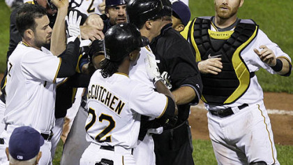 Pirates pitcher Jeff Karstens, middle center facing right, is helped out of an altercation with Brewers catcher Jason Kendall, left center facing camera, by teammate Andre McCutchen during the eighth inning.  At far left is Pirates infielder Ramon Vazquez and at far right is Pirates catcher Ryan Doumit.