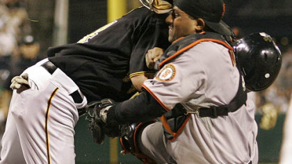Giants catcher Bengie Molina holds onto the ball after colliding with Pirates outfielder Brandon Moss who was attempting to score in the seventh inning.