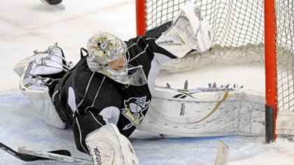 Penguins goalie Marc-Andre Fleury stops a shot by center Sidney Crosby during practice yesterday at Mellon Arena before leaving for Detroit to play Game 7 of the Stanley Cup final.