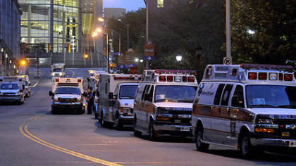 Ambulances line up outside the entrance of the old Children's Hospital on DeSoto Street in Oakland around 6 a.m. today to transport patients to the hospital's  new Lawrenceville home.