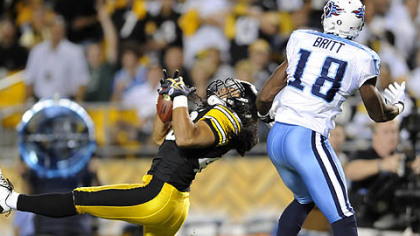Steelers saftey Troy Polamalu intercepts a pass intended for Titans wide receiver Kenny Britt in the first quarter Thursday at Heinz Field. Polamalu left the game in the second quarter due to a knee injury and did not return.