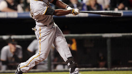 Andrew McCutchen follows through with his swing after connecting for a triple to drive in three runs against the Colorado Rockies in the seventh inning of last night&#039;s  baseball game in Denver.