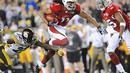 Cardinals receiver Larry Fitzgerald runs for a second-half first down last night in Super Bowl XLIII in Tampa, Fla.