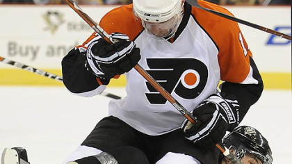 Evgeni Malkin is taken down by the Flyers' Jeff Carter in the first period.
