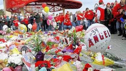 Angels fans gather around a temporary memorial for Los Angeles rookie pitcher Nick Adenhart before the game against the Red Sox last night in Anaheim, Calif.