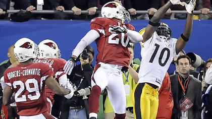 Steelers wide receiver Santonio Holmes pulls in the winning touchdown pass against the Cardinals in Super Bowl XLIII.