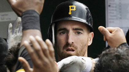 Adam LaRoche is greeted in the Pirates dugout after scoring off a hit by Ramon Vazquez during the fourth inning of yesterday's game against the Chicago Cubs.