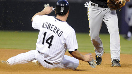 The Chicago White Sox's Paul Konerko, left, is forced out at second by Pirates shortstop Jack Wilson, right, during the fourth inning of last night's baseball game in Chicago.