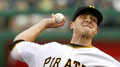 Pirates pitcher Kevin Hart pitches in the third inning of his first game as a Pirate.