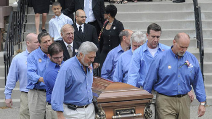 Billy Mays&#039; casket is carried out of St. John of God Catholic Church in McKees Rocks following his funeral Mass.