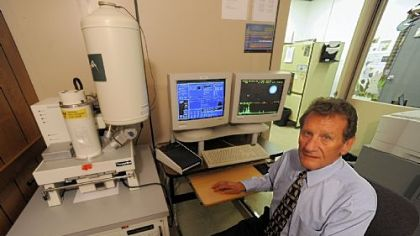 "A.J. ""Skip"" Schwoeble, director of forensic science at RJ Lee Group Inc., sits with a scanning electron microscope linked to a computer at the company's headquarters in Monroeville."